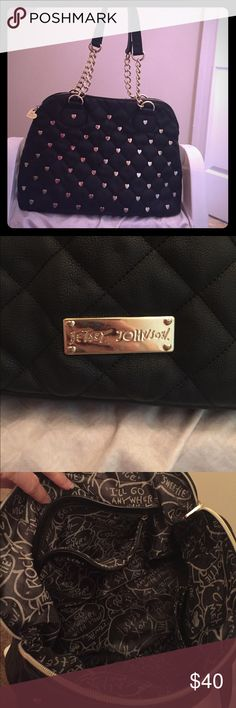 Betsy Johnson black heart studded purse Black with gold heart studs on one side. Big purse with lots of pockets and interior zipper pouch. Great condition. Purse zipper goes all the way across so nothing spills out. Betsey Johnson Bags Shoulder Bags