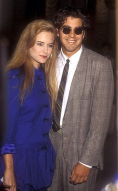 George Clooney and Kelly Preston lived together while dating in 1988 | See other throwback celebrity couples