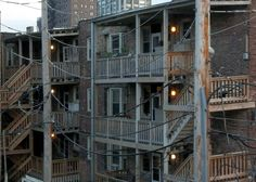 """The Alley.  Chicago porches connecting the back of buildings with a way to get to the ground.  The brick used here was cheaper, and not as nice looking as the brick on the front of the structures.  The """"porches"""" there were all enclosed"""