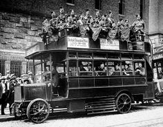 A Fifth Avenue Coach double-decker bus is being used to advertise the need for American volunteers during WWI.