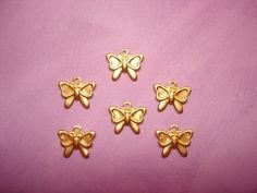 SALE---1.00---6 Tiny Bow Brass Jewelry Charms on Etsy