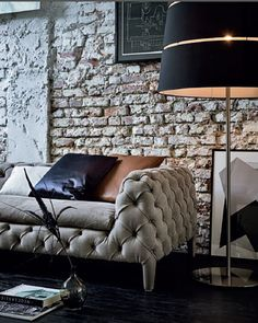 Love all the texture here!! Brick wall/Quilted classic suede couch!! Love calming cool colors. This would look amazing with my newly painted living room-raspberry ice walls with a pop of mulberry .......pics to follow