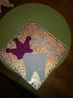 Would be cute with a pair of poms or a cheer bow and an apple instead of a crown and a tooth!