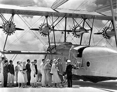 Passengers boarding a Sikorsky S-40 of Pan American Airlines at Dinner Key, Fla., 1931.