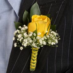 A single rose in Solar Power accented with a ring of baby's breath creates a classic yet standout boutonniere.