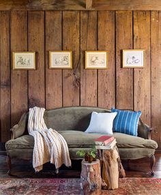 Kurt outfitted the restored log cabin with simple, understated pieces that felt in keeping with the historic structure. Four English engravings of farm animals hang above a green mohair sofa in the cozy living room.