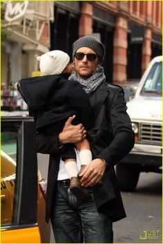 The hat... on the kid; oh yes and the one on his dad. Scarves, etc.. All over winter wear.