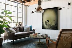 """My friend and colleague, Ashley Bothwell, bought this industrial loft in an artsy neighborhood in Atlanta,"" Flynn says. ""She wanted the loft to feel like a traditional house. It was a very fast, very affordable remodel."" Sofa and chair, HD Buttercup, hdbuttercup.com. Rug, Moattar; moattar.com. Artwork, Courtney J. Garrett, cjg.trumedia.io."
