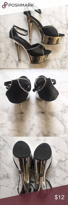 Strut Your Stuff in These Black and Silver Pumps Good Condition! Extremely stylish black and silver Pumps. Wear them with jeans or a pair of black faux leather leggings. Size 10. Adjustable straps. Shoes Platforms