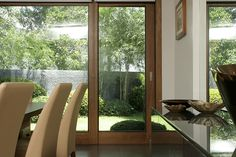 The space offers a picturesque view of the outside garden thanks to large sliding doors that also allow guests to flow in and out of the house with ease.