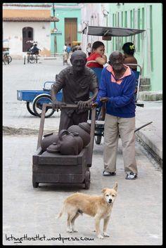 Bones & stone, old man, dog, Cuba, Cienfuegos, statue,  https://letsgetlostlet.wordpress.com/2015/06/11/iron-bones/