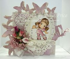 My card fraturing Tilda with Dripping Ice cream from the Pink Lemonade collection and Doohickey die So Wrapped Lovely Heart Tag, Marianne Designs Petra Large Oval and Tim Holtz Butterflight https://julieprice3.wordpress.com/2015/01/19/tilda-with-dripping-ice-cream/