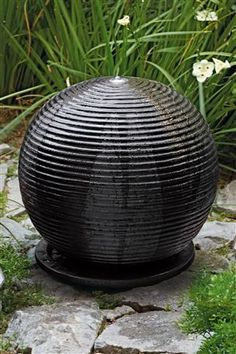 Black Ribbed Resin Sphere Water Feature