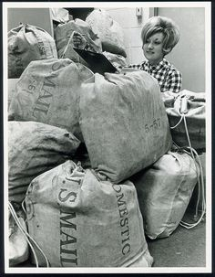 Office worker Mary Ann Quigley keeping track of sacks of mail received at Busch Stadium requesting tickets for the 1968 St. Louis Cardinals playoff season. ©Missouri History Museum
