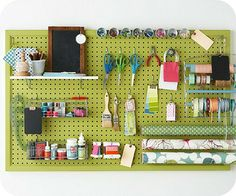 Use peg board for hanging my scissors, large rulers, ribbon, tulle, twine, gift bags, baskets for cards, and so much more. One might even  painting the peg board a fun color to add brightness to the room.