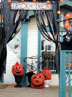 porch black drapes halloween decor  I am pinning not for link but for pic to remind myself I can use cheap black plastic dollar store tablecloths and do this.