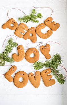 Make Gingerbread Letter Garlands. Also fun to personalize with names and kids to help thread string through. Festive on the tree or a cute personalized edible gift.