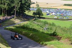 Racing on the hill, full car park and harvesting in the background, a typical summers day at Shelsley Walsh. Photo Credit: Mark Constanduros