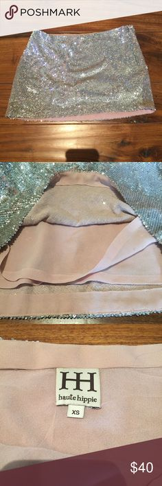 Silver Sequins Mini Skirt In good condition. As far as I know its never been worn. Haute Hippie Skirts Mini