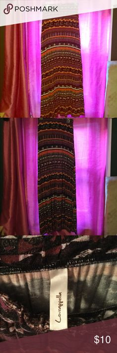 Large maxi skirt Definitely well worn and colors are noticeably faded, yet something I still have s tough time parting with considering how much I love the colors and patterns. Loveappella Skirts Maxi