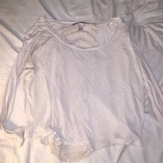 White long sleeve Lace down back. Small stain as shown. Hardly noticeable. Runs small Forever 21 Tops Tees - Long Sleeve