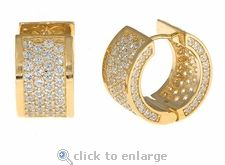 Ziamond Cubic Zirconia Pave Huggie Hoop Earrings in 14k yellow gold.  The Cirelli Small Huggie Hoop Earrings feature approximately 5 carats in total carat weight. #ziamond #cubic zirconia #earrings #huggie #hoops #pave