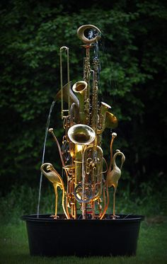 Honk Fest is a water feature made from upcycled musical instruments, brass collectables and plumbing parts - WaterWorks Garden Art via Recyclart Recycled Garden, Recycled Art, Repurposed, Garden Fountains, Water Fountains, Diy Fountain, Garden Totems, Glass Garden, Water Features In The Garden