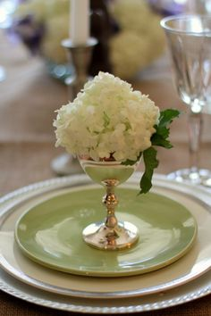 A single stem flower in a silver cup adds a pretty touch to your place settings!