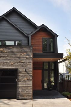 Recliamed exterior siding exterior contemporary with rustic wood siding floor-to-ceiling windows