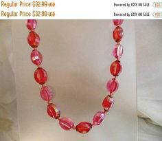 This #vintage faceted hot pink necklace is just lovely and unique!  It features two shades of pink with an AB (aurora borealis) coating on the Lucite beads.  The barrel bead... #ecochic #etsy #jewelry #jewellery