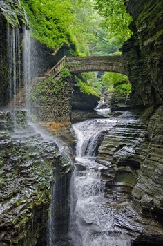 Watkins Glen State Park  -  is in a 400-foot-deep narrow gorge cut through rock by a stream that was left hanging when glaciers of the Ice age deepened the Seneca valley, increasing the tributary stream gradient to create rapids and waterfalls wherever there were layers of hard rock.