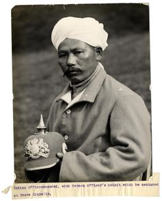 WW1. Wounded Indian Officer with German helmet he captured at Neuve Chapelle…