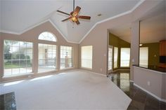 9407 PEARSALL DR HOUSTON, TX 77064: Photo Family Room: Vaulted ceilings, updated fan, crown molding and a wall of windows overlooking the lush backyard.