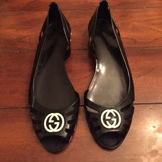 GUCCI flats. Jelly/rubber. Worn 2x EUC size 38/8 These are authentic Gucci flats. Jelly/rubber with logo on toe and sole. In excellent condition as shown in pictures. Bought at Neiman Marcus in Atlanta. Black with white logo. Size 38/8. Gucci Shoes Flats & Loafers