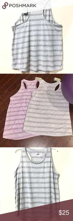 Plus Size TEK GEAR Stripe Racerback Fitness Tanks Give your fitness style a boost with this Plus Size Tek Gear racerback tank. Includes 2 tanks- Purple and Gray.   PRODUCT FEATURES 	•	Shirttail hem 	•	Crewneck 	•	Striped pattern 	•	Dry Tek Moisture-wicking technology 	•	Racerback FIT & SIZING 	•	27.25 approximate length from shoulder to hem FABRIC & CARE 	•	Polyester, linen 	•	Machine Wash 	•	Imported tek gear Tops Tank Tops