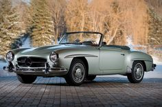 Born as a cheaper alternative to Mercedes' 300 SL track weapon, the 190 SL looked similar but had a more typical chassis construction and a 1.9-liter four-cylinder motor. The 190 SL was a grand tourer through and through, being more...