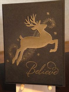 Christmas Card - Stamps:  Stampabilities Believe 02, Stampin' Up Star of Light - Essentials by Ellen Leaping Deer Die - Versamark Ink - Nuvo Classic Gold Embossing Powder - The Paper Studio Heavy Weight Black Cardstock - Inspiration:  https://www.bloglovin.com/blogs/stamping-with-loll-5195223/gilded-reindeer-4661639538