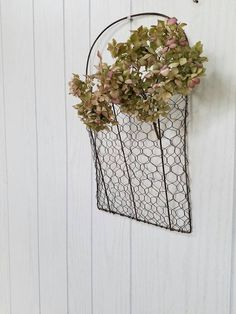 Chicken wire wall pocket  Perfect for holding your own favorite cotton bolls, flowers or greenery  The chicken wire wall pocket measures total with handle 16 H basket is 10 H x 9  W x 3 deep  Burlap & Flowers not included  perfect for gift giving  smoke/pet free home all sales are final thanks