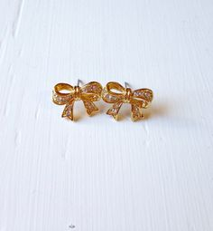 A personal favorite from my Etsy shop https://www.etsy.com/listing/253555114/10-dollar-clearance-vintage-gold-bow