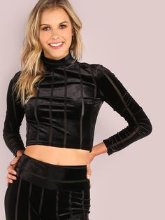 """Skinnify that body of yours with this sleek piece. Featuring a mock neckline, long sleeve arms, soft velvet material with mesh contrasting stripes, a cropped bodice and a back zip closure. Top measures 17.2"""" in. from top to bottom hem. Compliment with the matching leggings or throw on a moto skirt. Model is pictured in a size S. #MakeMeChic #style #fashion #newarrivals #fall16 #monochrome"""
