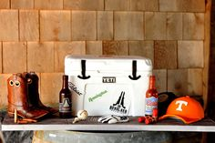 Cody & Bryan's custom Yeti Cooler Groom's Cake incorporated his varied interests Ariat Boots, the tires on his truck, Nike golf glove, TN Vols ball cap, shotgun shells, bullets,hand-poured sugar Beer bottles. Bryan was over the moon happy with his cake on their wedding day which in turn made us happy! We had so much fun working with this wonderful couple!
