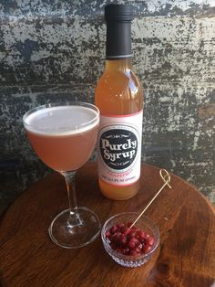 Purely Passion: In a cocktail shaker, combine ice, 1.5 oz. vodka, 0.5 oz. real pomegranate grenadine, 0.5 oz. Purely Syrup Grapefruit, and 0.5 oz. fresh lime juice., and two tablespoons of pomegranate seeds. Shake vigorously and strain into chilled Nick & Nora glass.  Garnish with grapefruit peel. Enjoy!
