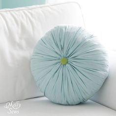 Love the texture on this Round Pleated Pillow Tutorial - Melly Sews