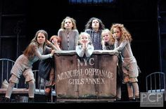 Most of the girls in the Broadway revival seem to have a sort of messy/curly half up half down thing going on.