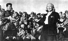 Lyubov Orlova, a highly popular Soviet actress, sings for the troops, summer 1944. Orlova and other entertainers were mobilized by the rough equivalent of the Soviet USO under the jurisdictional direction of the military.