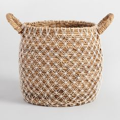 Charming form meets handy function in our large Bianca basket, handwoven in Indonesia of natural seagrass with an elegant macrame overlay.
