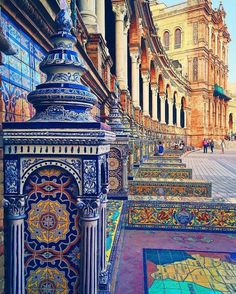 Plaza de España.. Sevilla ❤  I love all the colors.  I think it's really cool that the mosaics are part of a building because you don't find that very often in America.