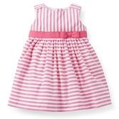 What a cute set! Bright stripes, a sweet pre-tied bow and tulle underlay makes this dress extra special.