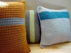 Crocheted Cushions. Try a big knit, no crazy design just simple stripes for pillows.
