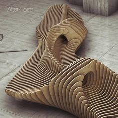 Parametric bench by Russian designer Oleg Soroko. The parametric benches are made of sections of plywood bonded rods.